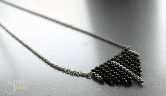 {A Smith of All Trades} Geometric Necklace