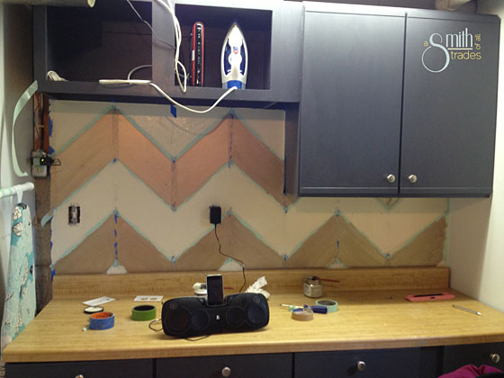 {A Smith of All Trades} Chevron wall taped up and painted