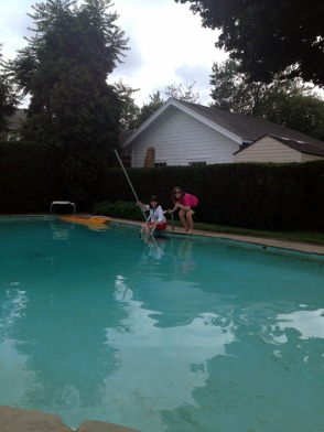 Em and Aunt Linda pose while rescuing the pool skimmer from the bottom of the pool. It was quite an ordeal.
